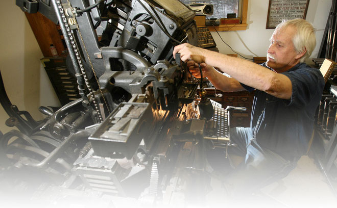 Mike Coughlin making adjustments on his Linotype